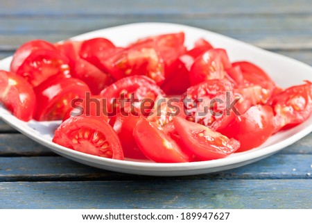 Chopped ripe tomatoes on a white plate