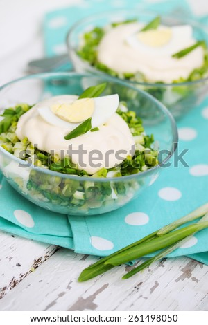 Chopped salad with egg, ramson and mayonnaise