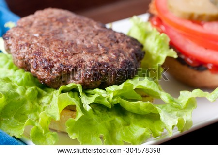 chopped sirloin hamburger with farm fresh fixings on a sesame seed bun
