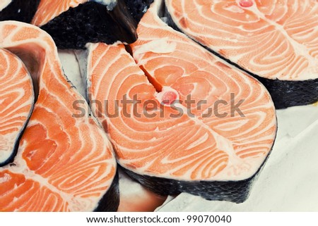 Chopped slamon steak in an italian fish market - stock photo
