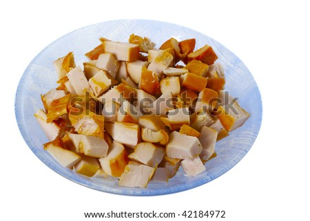 chopped smoked chicken meat in the blue plate ready for the appetizer or fondue isolated on white - stock photo