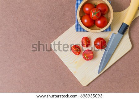 Chopped tomatoes and knife on cutting board