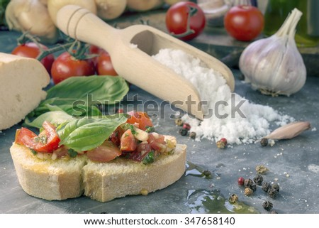 chopped tomatoes and other ingredients for typical Italian bruschetta - stock photo