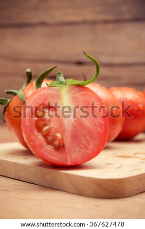 chopped tomatoes on old wooden background