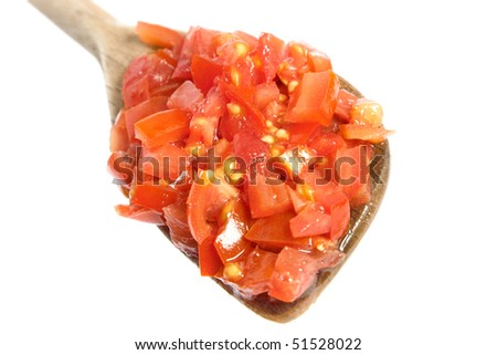 Chopped tomatoes on wooden spoon - stock photo