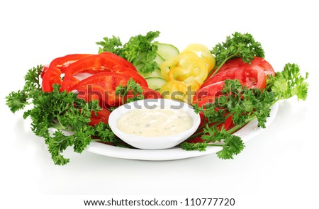 Chopped vegetables and sauce on plate isolated on white