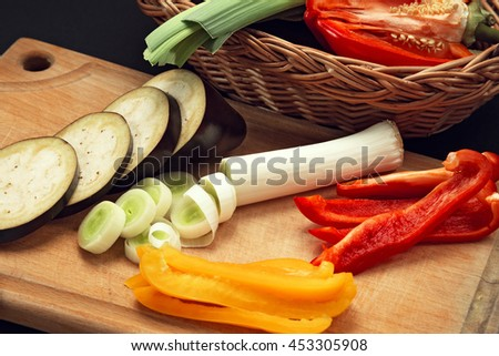 Chopped vegetables for cooking on a cutting board.