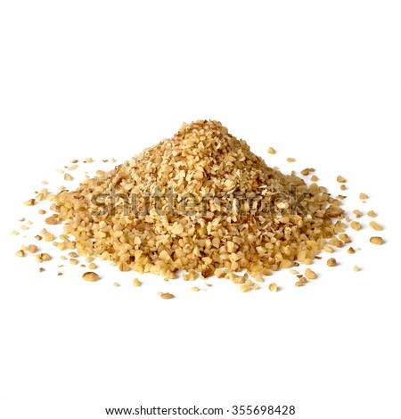 Chopped walnuts pile on white background - stock photo