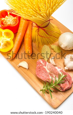 Chopping board full of food ingredients. - stock photo