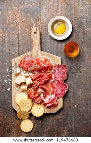 Chopping board of Assorted Cured Meats, Cheese and Honey - stock photo