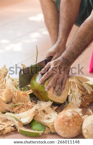 Chopping coconut by knife