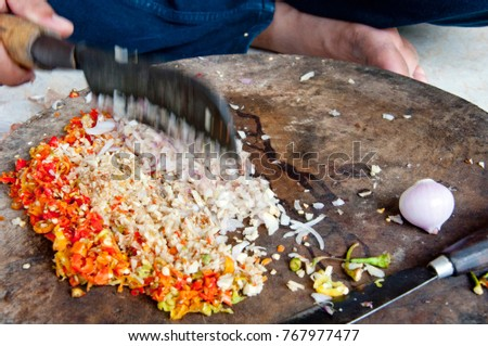 Chopping of the ingredients of sambal matah, a traditional Balinese style raw sambal