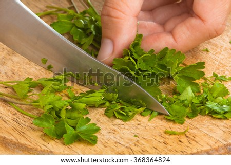 chopping parsley leaves on the cutting board