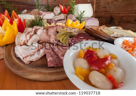 Chopping with typical italian cold cuts - stock photo