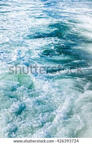 Choppy water of an ocean wake in the Atlantic Ocean at Virginia Beach - stock photo