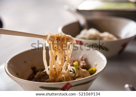 Chopstick hold Thai noodle