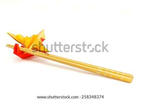 Chopstick Wrapper Bird / A traditional Japanese paper craftsused when congratulating a wedding, new year birthday. - stock photo
