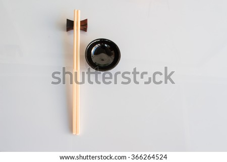 Chopsticks and bowl were empty on white background.  can up for display of your product. - stock photo