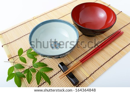 Chopsticks and bowls - stock photo