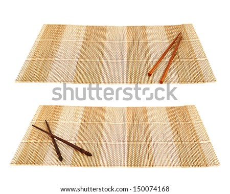 Chopsticks eating utensils over a bamboo mat composition, isolated over white background, set of two foreshortenings - stock photo