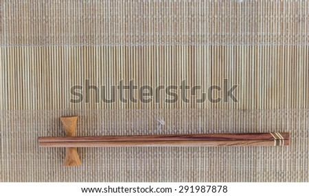 chopsticks on a bamboo mat - stock photo