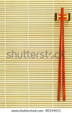 chopsticks on bamboo background - stock photo
