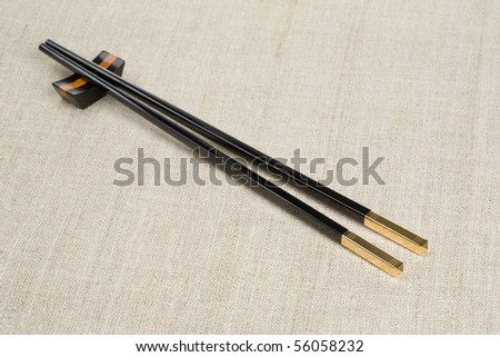 Chopsticks on canvas. - stock photo