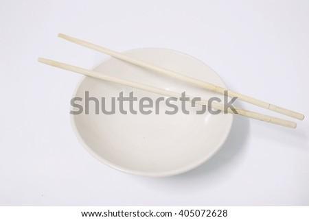chopsticks with ceramic bowl - stock photo