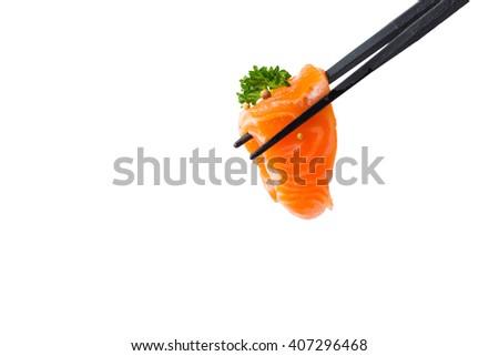 Chopsticks with fresh salmon isolated on white background. - stock photo
