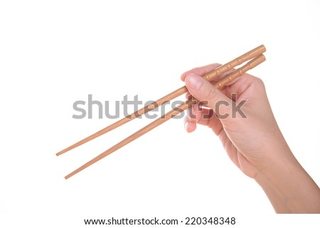 chopsticks with hand on a white background isolated - stock photo