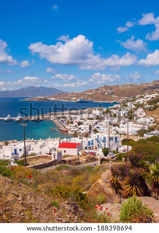 Chora Mykonos with port on the background of the sea, islands and the blue sky with clouds - stock photo