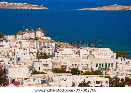 Chora Mykonos with windmills on the background of the sea and islands - stock photo