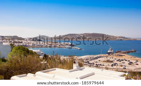 Chora Mykonos with windmills on the background of the sea and port - stock photo