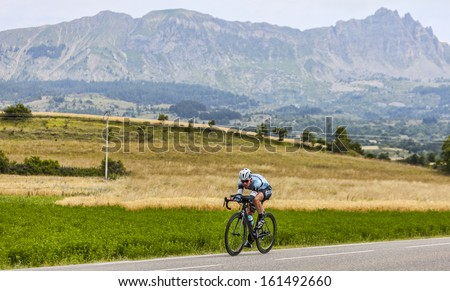 CHORGES, FRANCE- JUL 17:The Manx cyclist Mark Cavendish pedaling during the stage 17 of 100th edition of Le Tour de France, a time trial between Embrun and Chorges on July 17 2013 - stock photo