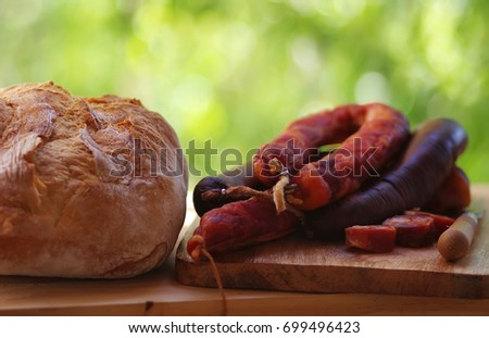 Chorizo Meat and bread om table, manufacture of Portugal
