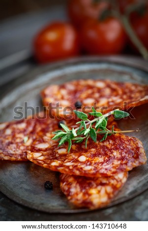 Chorizo salami sausage on  rustic background. Meat cold cuts. - stock photo
