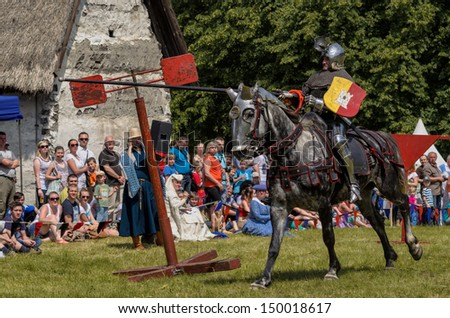 CHORZOW,POLAND, JUNE 9: Medieval knight on horseback showing their skills during a IV Convention of Christian Knighthood on June 9, 2013, in Chorzow