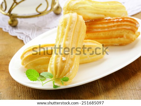 choux pastry dough eclairs with vanilla cream