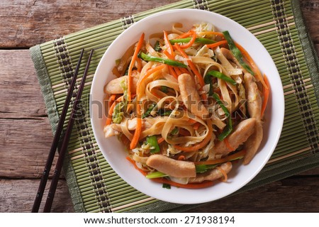 Chow Mein: fried noodles with chicken and vegetables close-up. horizontal view from above  - stock photo