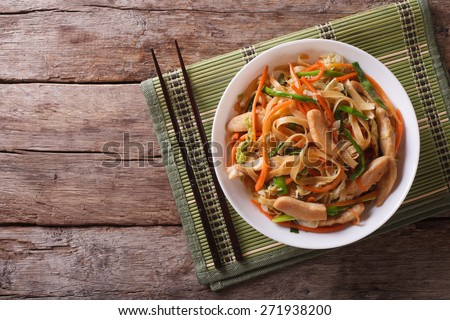 Chow Mein: fried noodles with chicken and vegetables. horizontal view from above  - stock photo