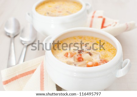 Chowder soup with vegetables, curry and heavy cream