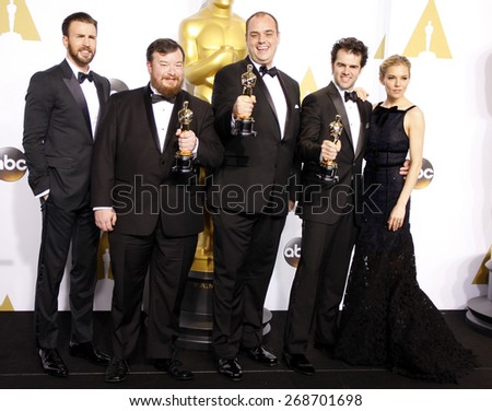 Chris Evans, Ben Wilkins, Thomas Curley, Craig Mann and Sienna Miller at the 87th Annual Academy Awards Press Room held at the Loews Hollywood Hotel in Hollywood on February 22, 2015.
