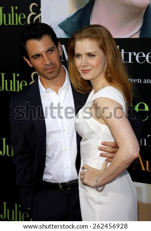 Chris Messina and Amy Adams at the Los Angeles premiere of 'Julie and Julia' held at the Mann Village Theatre in Westwood, USA. July 27, 2009.  - stock photo