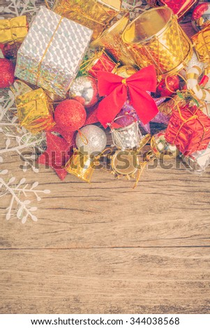Chrismas baubles and vary of decoration on wood background,vintage color