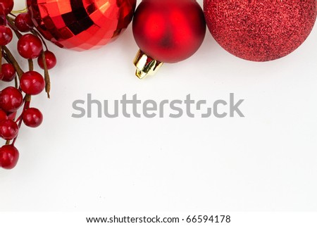 Chrismas red baubles and red berries on white background - stock photo