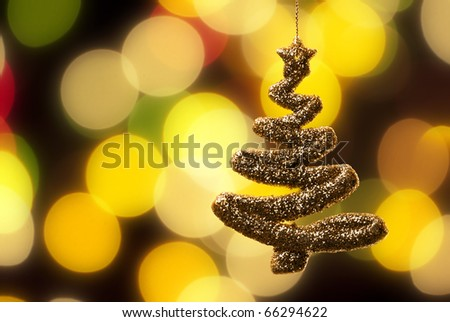 Chrismas tree detail over abstract blurry light background. - stock photo