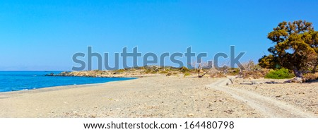 Chrissi is an uninhabited Greek island approximately 15 kilometers south of Crete close to Ierapetra in the Libyan Sea. The island hosts the largest naturally formed Lebanon cedar forest in Europe. - stock photo