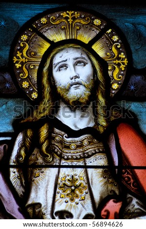 Christ looking to heaven stained glass window A Victorian stained glass window depicting Jesus Christ looking to heaven. Window created over 100 years ago, on public display. - stock photo