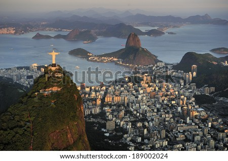 Christ, symbol of Rio de Janeiro, standing on top of Corcovado Hill, overlooking Guanabara Bay and Sugarloaf, Rio de Janeiro, Brazil - stock photo