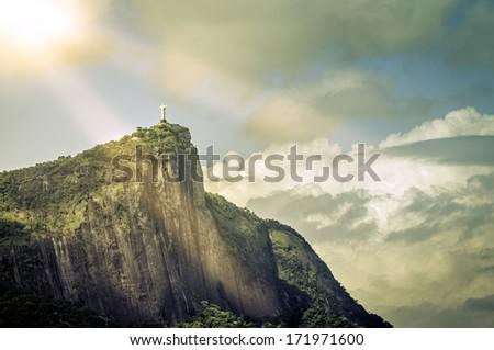 Christ the Redeemer in the sun rays,  Rio de Janeiro, Brazil - stock photo